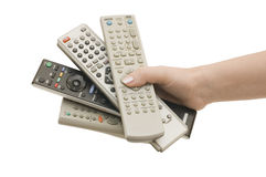Four Remote Control In A Hand Stock Image