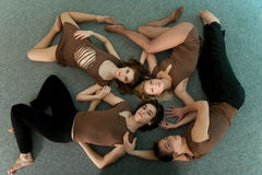 Four resting dancers Stock Images