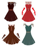 Four retro dresses Stock Photos