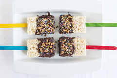 Four Rice Krispie cakes dipped in chocolate. stock photography