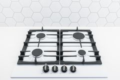 Four ring gas hob cooker. Gas flame cooker hob top in classic white stock images