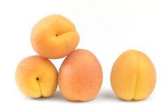 Four ripe apricots isolated on white background Stock Photo