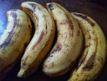 Four ripe banana on the table. royalty free stock photos