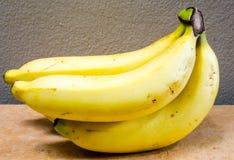 Four ripe bananas. A small bunch of ripe yellow bananas Royalty Free Stock Image