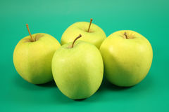 Four ripe green apples Royalty Free Stock Photography
