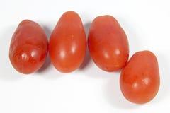 Four Ripe Mini Italian Tomatoes on White Stock Photos