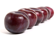 Four ripe plums Stock Photo