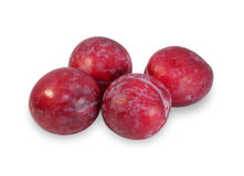 Four ripe plums, isolated Stock Images