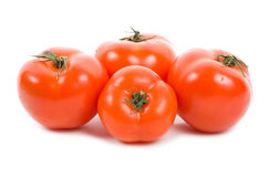 Four ripe tomatoes Stock Photos