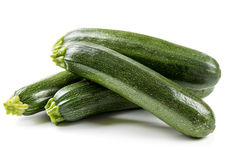Four ripe zucchini Stock Images