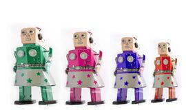 Four robot girls looking forward is. Olated Stock Images