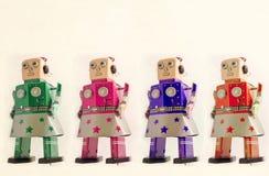 Four robot girls looking forward. Toned Stock Photos
