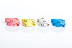 Four roll of colorful measuring tapes Stock Photography