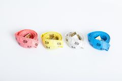 Four roll of colorful measuring tapes Royalty Free Stock Photo