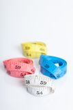 Four roll of colorful measuring tapes Royalty Free Stock Photography
