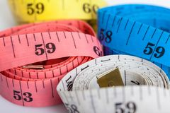 Four roll of colorful measuring tapes Stock Photo