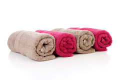 Four rolled colorful towels Stock Photos