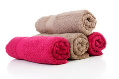 Four rolled colorful towels in red and brown Royalty Free Stock Photo