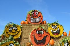 Halloween Hay Bales in Gervis, Oregon. These are four rolled hay bales at Bauman Farm in Gervis, Oregon decorated for Halloween with pumpkin faces in a display royalty free stock images