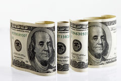 Four rolled hundred dollar bills 2 Royalty Free Stock Images