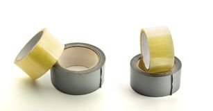 Four rolls of adhesive tape Stock Image