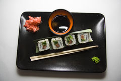 Four rolls on black plate 3 Royalty Free Stock Photography
