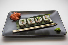 Four rolls on black plate Stock Photography