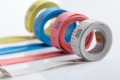 Four rolls of colorful measuring tapes Royalty Free Stock Photo