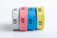Four rolls of colorful measuring tapes Royalty Free Stock Photography