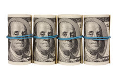 Four rolls from dollars Stock Photography