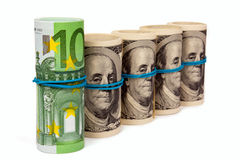 Four rolls from dollars and one roll from euros Royalty Free Stock Photo