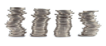 Four rolls made with coins Royalty Free Stock Photography