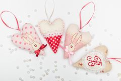Four romantic beautiful heart with a hare and a bow on a white background with pearls for a card. Four romantic beautiful heart with a hare and a bow on a white stock photography