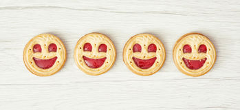 Four round biscuits smiling faces Royalty Free Stock Photo