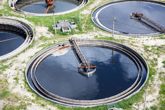 Four round full water settlers for sewage recycling Stock Photo