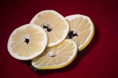 Sliced pomelo on a black plate stock photo