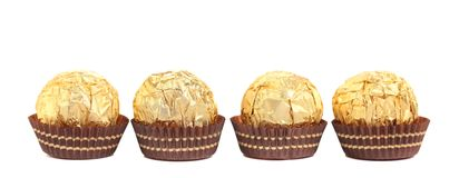 Four in row chocolate bonbons. Royalty Free Stock Images