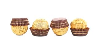 Four in row chocolate bonbons. Royalty Free Stock Image