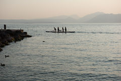 Four rowers rowing a boat standing Royalty Free Stock Image