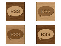 Four RSS wooden buttons Stock Photos
