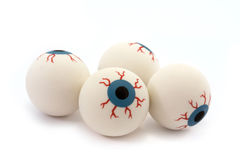 Four rubber toy eyeballs isolated on white Stock Photos