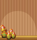 The four Russian dolls in front of an empty wall Royalty Free Stock Photo