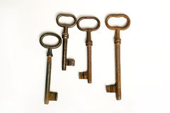 Four rusty keys Stock Images