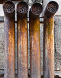 Four rusty pipes Stock Image