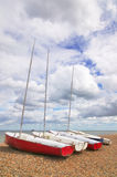 Four sailboats on a pebble beach Royalty Free Stock Photo