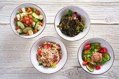 Four salad mix bowls healthy food Stock Photography
