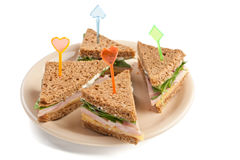 Four Sandwiches on a plate Royalty Free Stock Photo