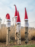 Four santa-claus garden gnomes. Four santa-claus style garden gnomes with red hats and white beards stock photography