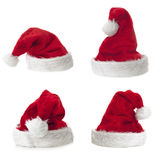 Four Santa Claus hat on white background Stock Photos