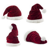 Four santa Claus hats on white background Royalty Free Stock Photo